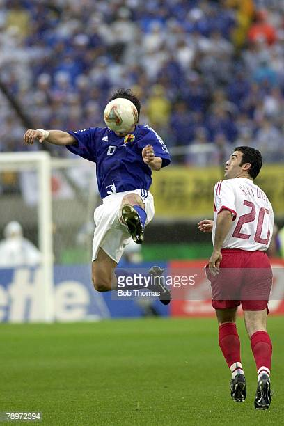 Football FIFA World Cup Finals Miyagi Japan 18th June 2002 Japan 0 v Turkey 1 Japan's Akinori Nishizawa jumps for the ball while watched by Turkey's...