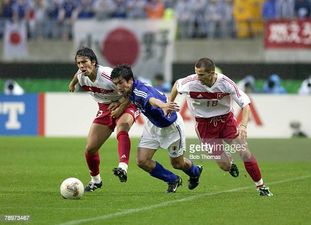 Football FIFA World Cup Finals Miyagi Japan 18th June 2002 Japan 0 v Turkey 1 Japan's Akinori Nishizawa tries to escape the challenges of Turkey's...