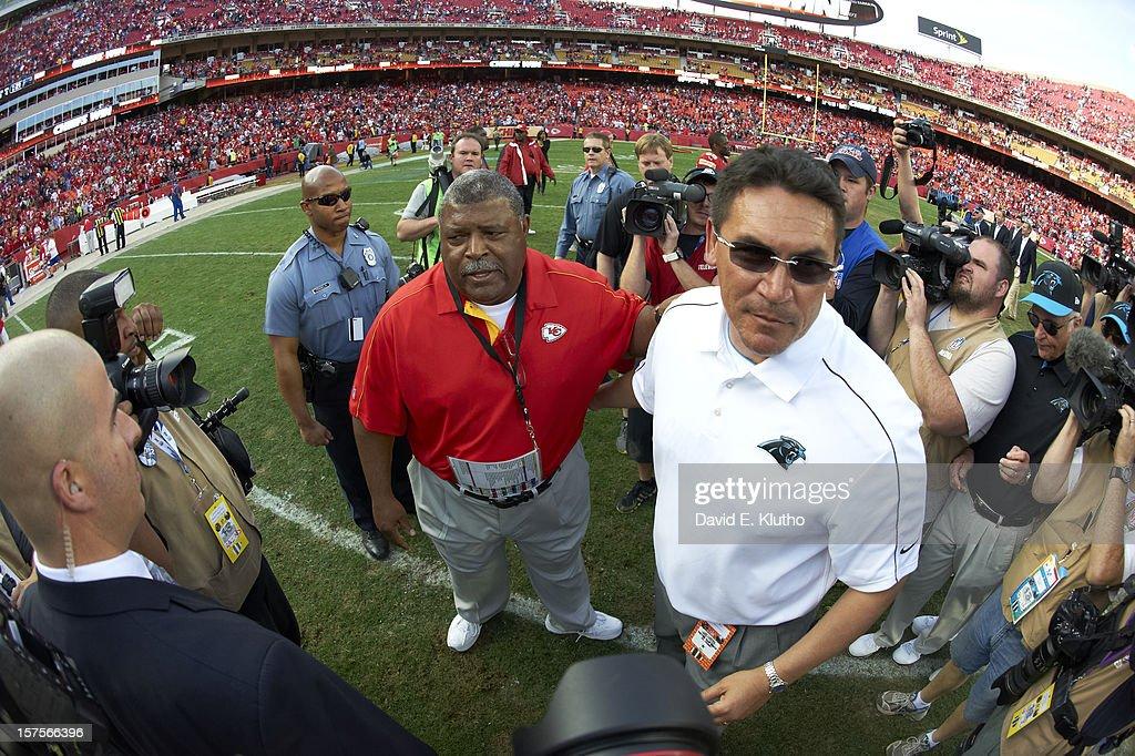 Fisheye view of Kansas City Chiefs head coach Romeo Crennel and Carolina Panthers head coach Ron Rivera on field after game at Arrowhead Stadium. David E. Klutho F13 )