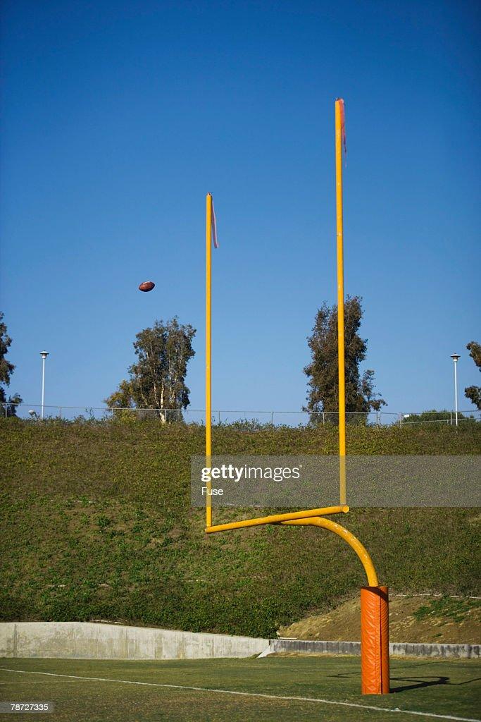 Football Flying Through Goalposts