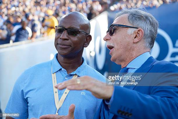 Former Los Angeles Rams player Eric Dickerson with team owner Stan Kroenke on field during preseason game vs Dallas Cowboys at Memorial Coliseum Los...