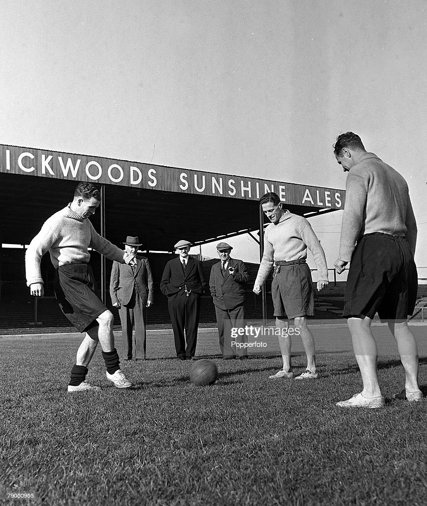 Football, 1948, Fratton Park, Portsmouth, England, A picture of three members of the founding Portsmouth FC team watching their 1948 counterparts training, Billy Smith, Ted Turner, and Harry Stringfellow watch Philip Rookes, Reg Flewin, and Herbert Barlow