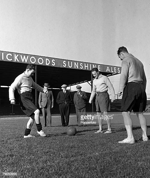 Football Fratton Park Portsmouth England A picture of three members of the founding Portsmouth FC team watching their 1948 counterparts training...