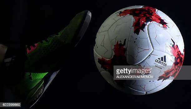 A football freestyler performs with the official match ball for the 2017 FIFA Confederations Cup named 'Krasava' during its unveiling ceremony in...