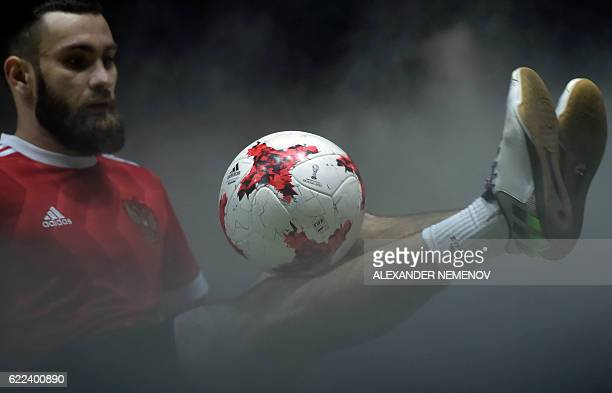 A football freestyler wearing the new Russia's national soccer team jersey performs with the official match ball for the 2017 FIFA Confederations Cup...