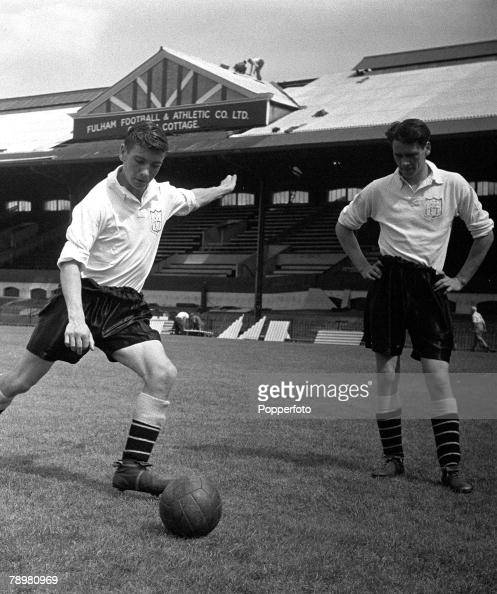 Football Fulham's Bobby Robson critically watches Johnny Haynes take a freekick during a training session at Craven Cottage