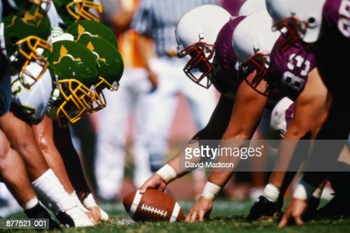 Football game, players at line of scrimmage