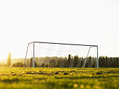 Football goal on pitch, ground view