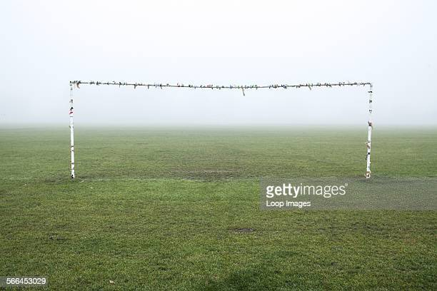 Football goal posts in the mist