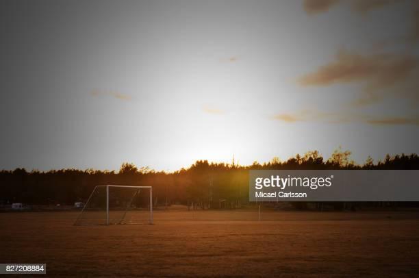 Football goal shot at sunset