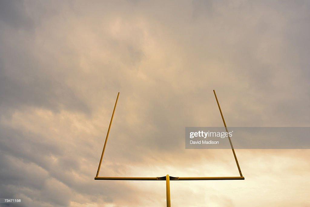 Football goalposts, low angle view, sunrise