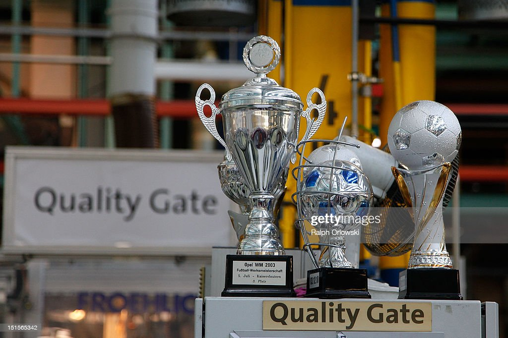Football goblets stand in quality gates management office at the manufacturing plant of German car maker Adam Opel GmbH on September 8, 2012 in Kaiserslautern, Germany. Automaker Opel, founded in 1862, celebrates their 150th anniversary.