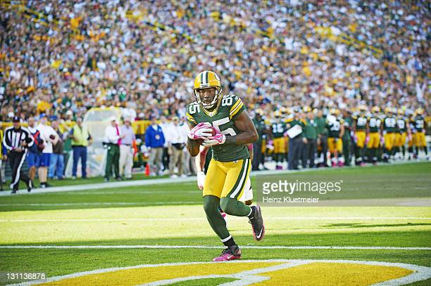 Green Bay Packers Greg Jennings in action scroing touchdown vs Denver Broncos at Lambeau Field Green Bay WI CREDIT Heinz Kluetmeier