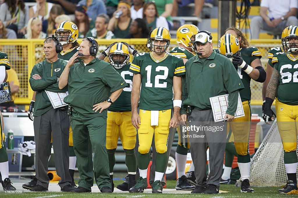 Green Bay Packers QB Aaron Rodgers (12) and head coach Mike McCarthy on sidelines during preseason game vs Seattle Seahawks at Lambeau Field. John Biever F87 )