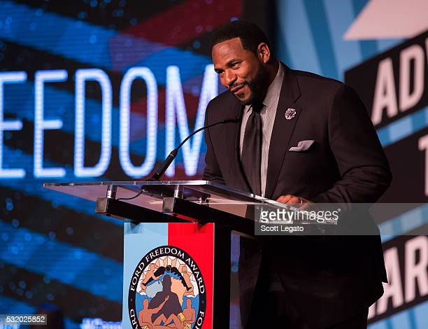 Football Hall of Famer Jerome 'The Bus' Bettis speaks at Max M Marjorie S Fisher Music Center during the 18th Annual Ford Freedom Award Event on May...