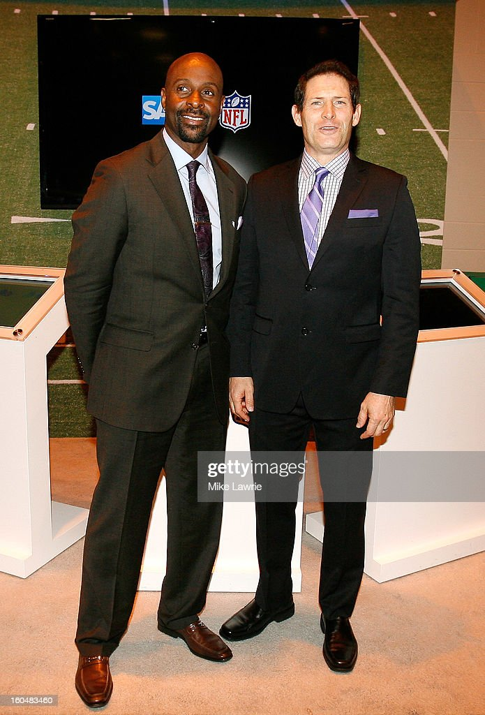 Football Hall of Famers Jerry Rice (L) and Steve Young pose for photos near Super Bowl XLVII Radio Row at the Ernest N. Morial Convention Center on January 31, 2013 in New Orleans, Louisiana.