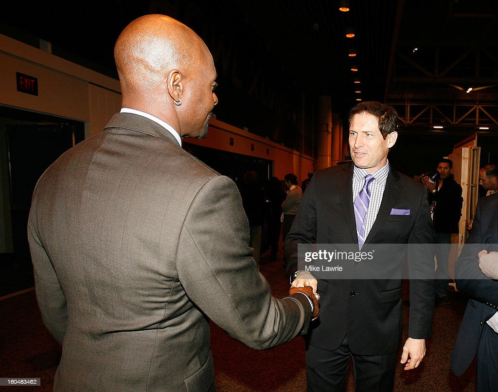Football Hall of Famers Jerry Rice (L) and Steve Young shake hands near Super Bowl XLVII Radio Row at the Ernest N. Morial Convention Center on January 31, 2013 in New Orleans, Louisiana.