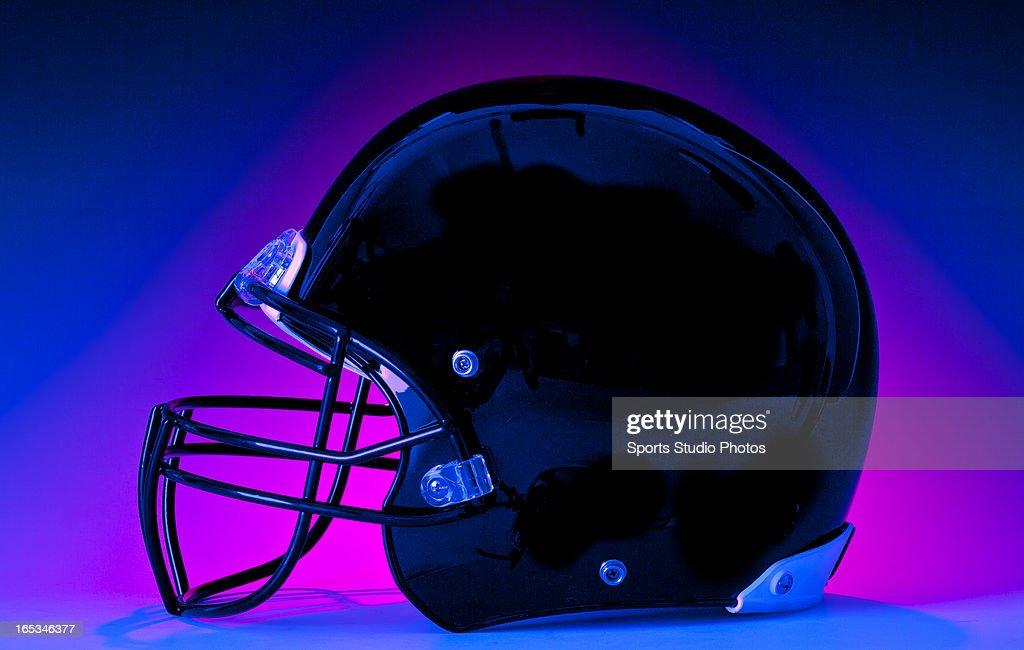 Football Helmet. Modern pro-style football helmet photographed in the studio.