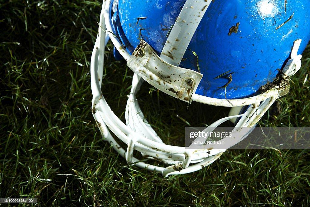 Football helmet on grass : Stock Photo