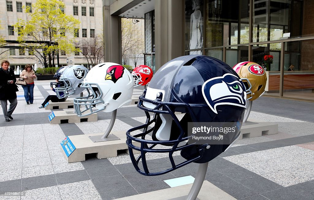 NFL football helmets are on display in Pioneer Court to commemorate the NFL Draft 2015 in Chicago on April 30 2015 in Chicago Illinois