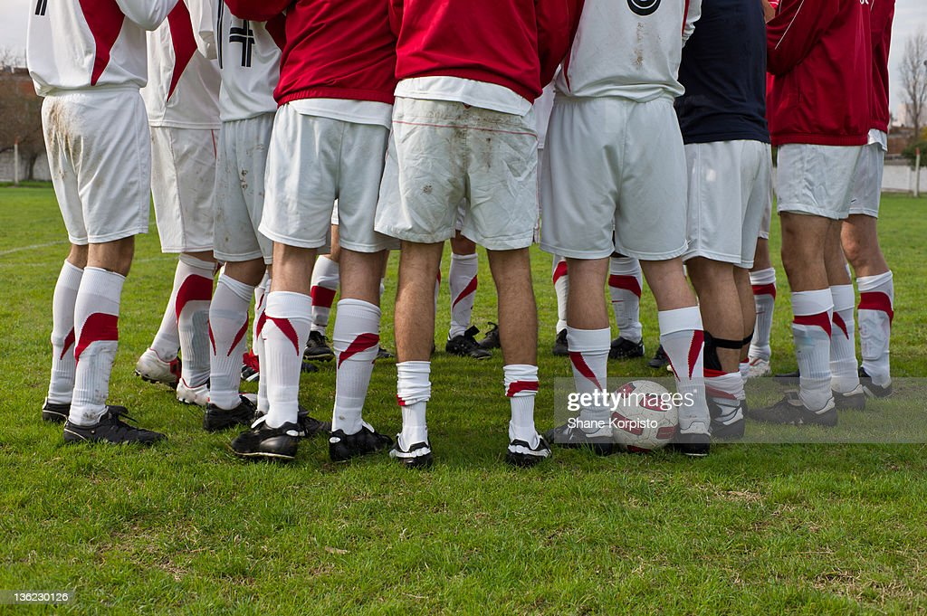 Football huddle : Stock Photo