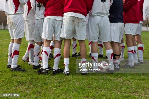 Football huddle : Stock Photo