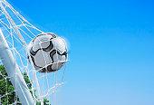 Football in a Net Against a Blue Sky