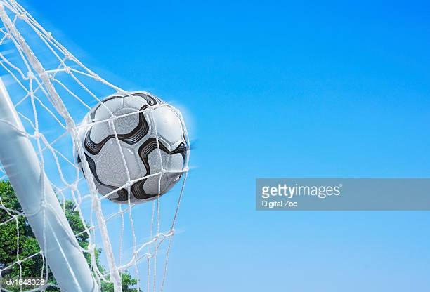 Football in a Net Against a Blue Sky