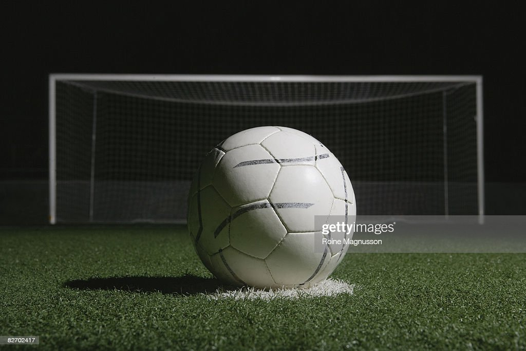 football in front of goal at night : Stock Photo