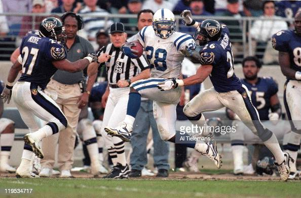 Indianapolis Colts Marshall Faulk in action vs Baltimore Ravens Rod Woodson at MT Bank Stadium Baltimore MD CREDIT Al Tielemans