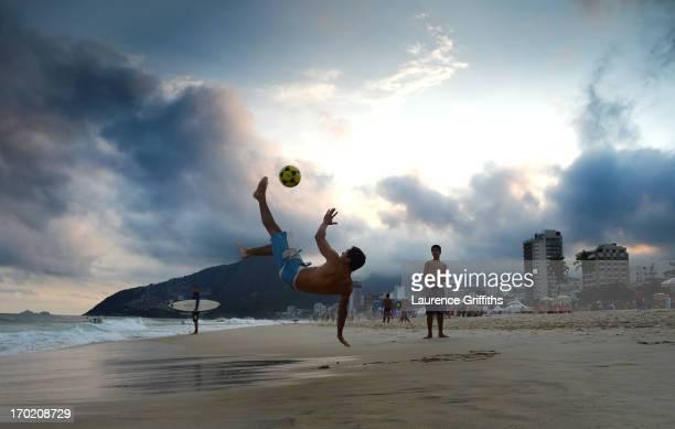 Football is played on Impanema beach at sunset on June 8 2013 in Rio de Janeiro Brazil
