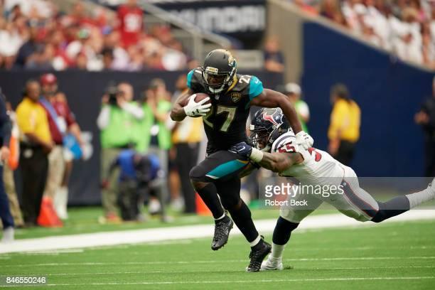 Jacksonville Jaguars Leonard Fournette in action rushing vs Houston Texans Benardrick McKinney at NRG Stadium Houston TX CREDIT Robert Beck