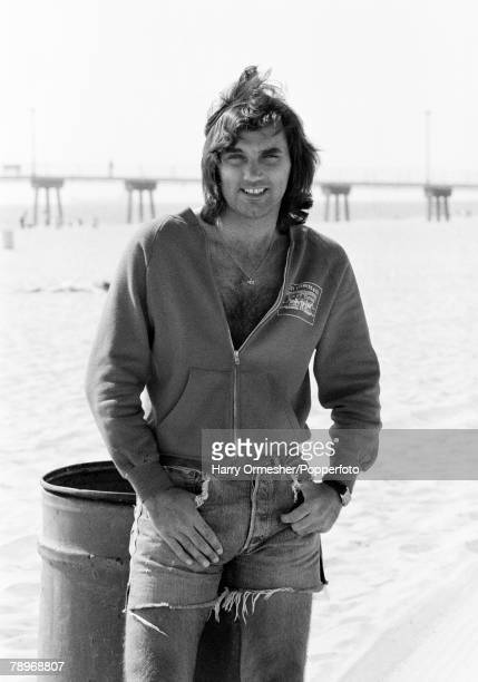 Football June 1977 USA George Best relaxes on Hermosa Beach while out in America playing for the LA Aztecs