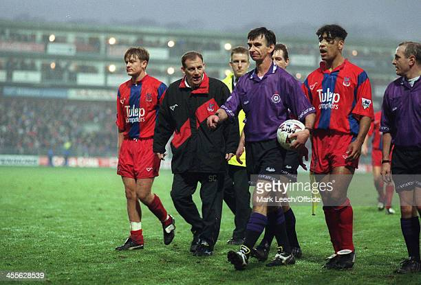 Football League Cup Crystal Palace v Arsenal Referee John Martin walks off with the matchball as Palace manager Steve Coppell and Richard Shaw...