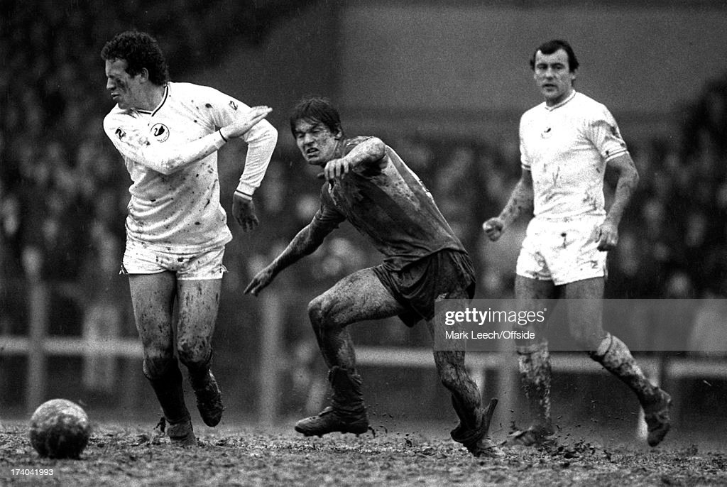 Football League Division One Swansea City v Stoke City Alan Curtis turns his face away as he is caught by the muddy hand of Stoke player Paul...
