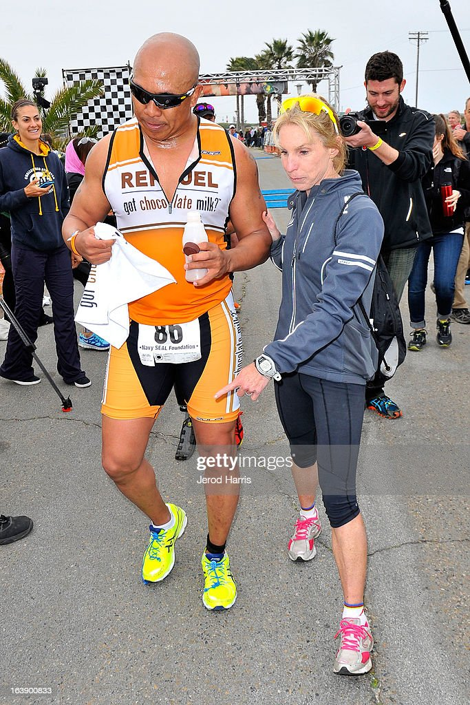 Football Legend Hines Ward and his coach 8 time Ironman World Championship winner Paula Newby Fraser celebrate with REFUEL | 'Got Chocolate Milk?' after finishing the SEAL Sprint III Triathlon on March 17, 2013 in San Diego, California.