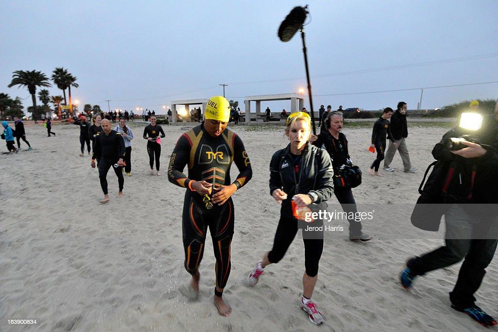 Football Legend Hines Ward and his coach 8 time Ironman World Championship winner Paula Newby Fraser walk to the starting line of the SEAL Sprint III Triathlon on March 17, 2013 in San Diego, California.