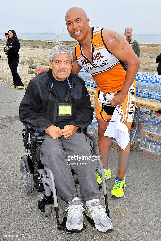 Football legend Hines Ward poses with retired Navy SEAL and founder of SEAL Sprint III Triathlon Moki Martin on March 17, 2013 in San Diego, California.