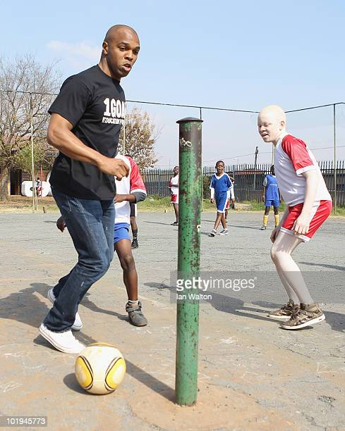 Football legend Quinton Fortune of Manchester United and South Africa plays fooball with some of the kid from the 1GOAL School at Winnie Ngwezi...