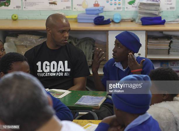 Football legend Quinton Fortune of Manchester United and South Africa meets some of the kid from the 1GOAL School at Winnie Ngwezi Primary school on...
