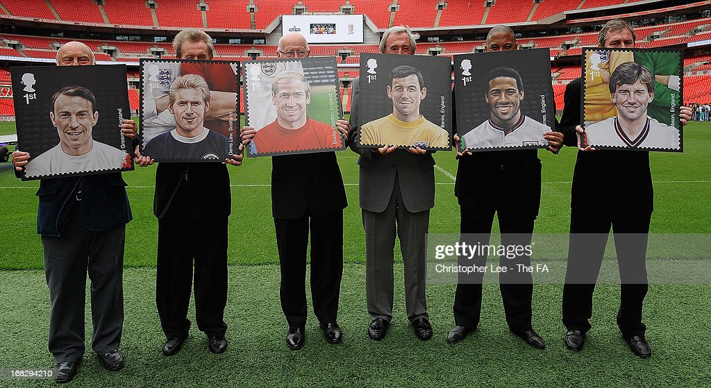 Football legends <a gi-track='captionPersonalityLinkClicked' href=/galleries/search?phrase=Jimmy+Greaves&family=editorial&specificpeople=209221 ng-click='$event.stopPropagation()'>Jimmy Greaves</a>, <a gi-track='captionPersonalityLinkClicked' href=/galleries/search?phrase=Denis+Law+-+Soccer+Player&family=editorial&specificpeople=15746096 ng-click='$event.stopPropagation()'>Denis Law</a>, Sir <a gi-track='captionPersonalityLinkClicked' href=/galleries/search?phrase=Bobby+Charlton&family=editorial&specificpeople=204207 ng-click='$event.stopPropagation()'>Bobby Charlton</a>, <a gi-track='captionPersonalityLinkClicked' href=/galleries/search?phrase=Gordon+Banks&family=editorial&specificpeople=215465 ng-click='$event.stopPropagation()'>Gordon Banks</a>, <a gi-track='captionPersonalityLinkClicked' href=/galleries/search?phrase=John+Barnes+-+Soccer+Player&family=editorial&specificpeople=13833127 ng-click='$event.stopPropagation()'>John Barnes</a> and <a gi-track='captionPersonalityLinkClicked' href=/galleries/search?phrase=Bryan+Robson&family=editorial&specificpeople=206232 ng-click='$event.stopPropagation()'>Bryan Robson</a> pose for the camera with their stamps during the Royal Mail Stamp Launch at Wembley Stadium on May 8, 2013 in London, England.