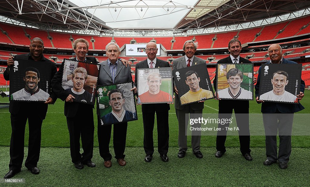 Football Legends, <a gi-track='captionPersonalityLinkClicked' href=/galleries/search?phrase=John+Barnes+-+Soccer+Player&family=editorial&specificpeople=13833127 ng-click='$event.stopPropagation()'>John Barnes</a>, <a gi-track='captionPersonalityLinkClicked' href=/galleries/search?phrase=Denis+Law+-+Soccer+Player&family=editorial&specificpeople=15746096 ng-click='$event.stopPropagation()'>Denis Law</a>, <a gi-track='captionPersonalityLinkClicked' href=/galleries/search?phrase=Dave+Mackay+-+Soccer+Player+-+Born+1934&family=editorial&specificpeople=14013516 ng-click='$event.stopPropagation()'>Dave Mackay</a>, Sir <a gi-track='captionPersonalityLinkClicked' href=/galleries/search?phrase=Bobby+Charlton&family=editorial&specificpeople=204207 ng-click='$event.stopPropagation()'>Bobby Charlton</a>, <a gi-track='captionPersonalityLinkClicked' href=/galleries/search?phrase=Gordon+Banks&family=editorial&specificpeople=215465 ng-click='$event.stopPropagation()'>Gordon Banks</a>, <a gi-track='captionPersonalityLinkClicked' href=/galleries/search?phrase=Bryan+Robson&family=editorial&specificpeople=206232 ng-click='$event.stopPropagation()'>Bryan Robson</a> and <a gi-track='captionPersonalityLinkClicked' href=/galleries/search?phrase=Jimmy+Greaves&family=editorial&specificpeople=209221 ng-click='$event.stopPropagation()'>Jimmy Greaves</a> pose for the camera with their stamps during the Royal Mail Stamp Launch at Wembley Stadium on May 8, 2013 in London, England.