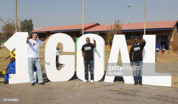 Football legends Socrates Andrew Cole and Quinton Fortune visit the 1GOAL School at Winnie Ngwezi Primary school on June 10 2010 in Johannesburg...