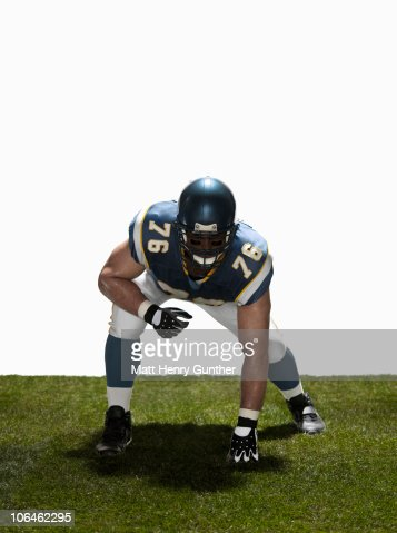 Football lineman in stance. Front view : Stock Photo