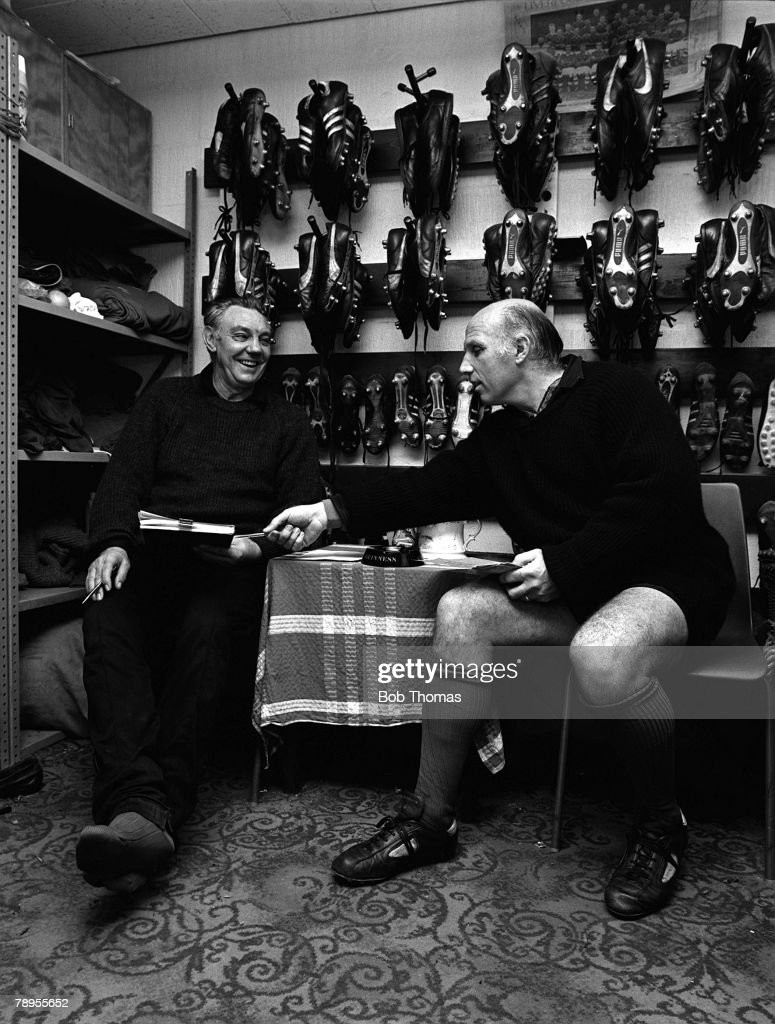 Football, 1983, Liverpool+s Assistant Manager Joe Fagan and Trainer Ronnie Moran discuss business in the boot-room at Anfield
