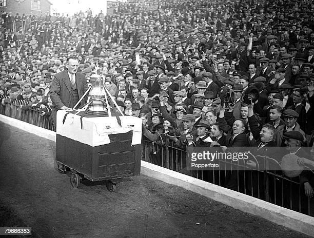 Football London England 27th April 1936 Cheered by thousands of their supporters the Arsenal FA Cup winning team parade the trophy around the...