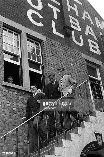 Football London England Fulham's Bobby Robson Bedford Jezzard and Johnny Haynes walk down the stairs at Craven Cottage