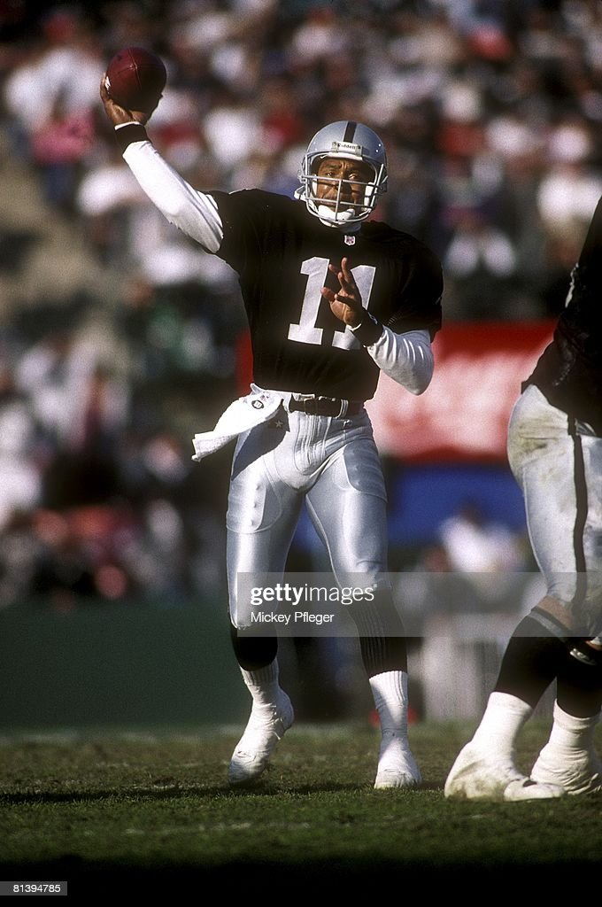 Los Angeles Raiders QB Vince Evans (11) in action, making pass vs San Francisco 49ers, Los Angeles, CA