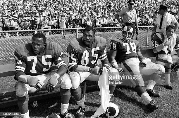 Los Angeles Rams Deacon Jones Lamar Lundy and Roger Brown on sidelines during game vs New Orleans Saints at Tulane Stadium New Orleans LA...