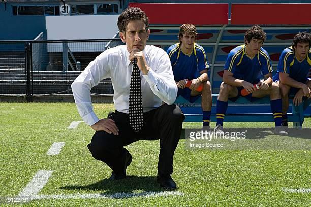 Football manager watching football match